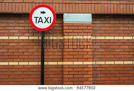 taxi sign brick wall