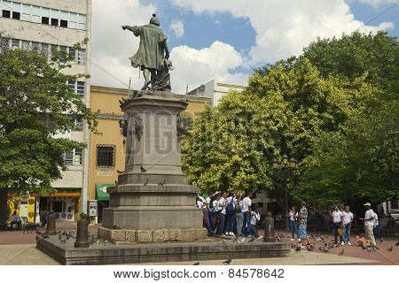 People make group photo at the monument to Christopher Columbus in Santo Domingo.