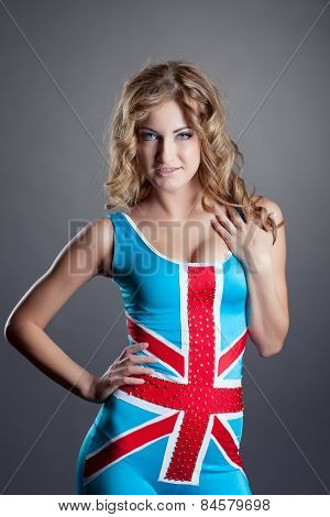 Cute dancer posing in costume with Union Jack