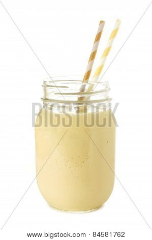 Banana smoothie in mason jar isolated