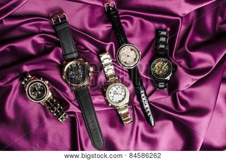Set Jewelry Watches On Red Silk