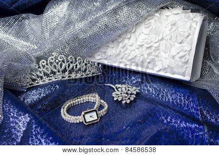 Set Of Female Accessories Of The Clutch, Watches, Brooches And Tiaras