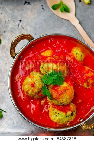 Fish Croquette In Tomato Sauce In A Copper Bowl