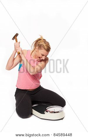 Young Woman Skin With A Hammer On The Scale