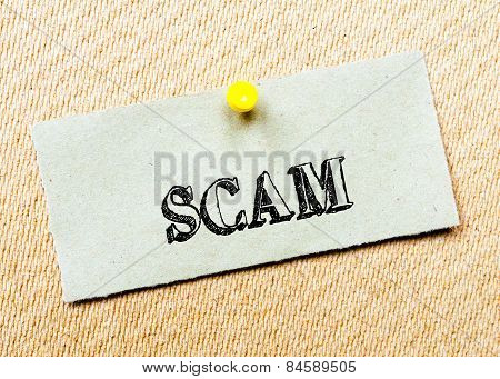 Recycled Paper Note Pinned On Cork Board. Scam Message. Concept Image