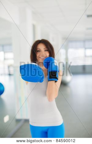 Attractive woman in training for boxing.