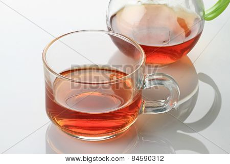 Tea Cup And Kettle On White Reflective Background
