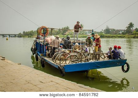 Crowded ferry transports people along the Thu Bòn River in Vietnam