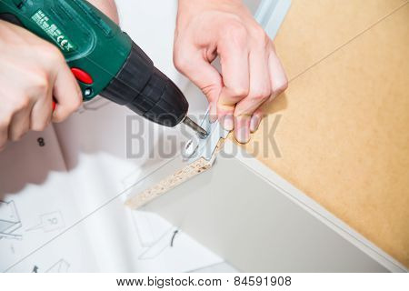 Assembling  Furniture With Electric Screwdriver Screwdriver
