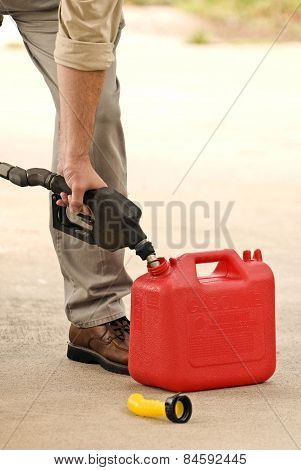 Hand Pumping Gasoline Or Fuel Into Container