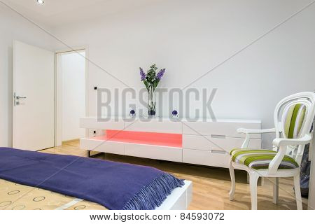 Bedroom with dresser and open door