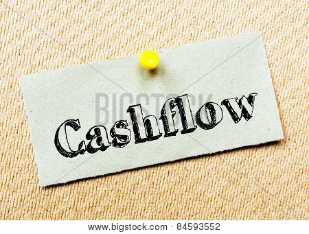Recycled Paper Note Pinned On Cork Board. Cashflow Message