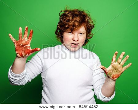 Expressive Boy Showing Colorful Hands After Drawing