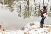 image of fishermen  - Fisherman on the river bank - JPG