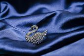 picture of brooch  - brooch in the form of a swan on silk waves - JPG