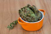 stock photo of artichoke hearts  - Fresh Raw artichokes on the wooden background - JPG