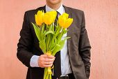 stock photo of bouquet  - A man wearing a business suit - JPG