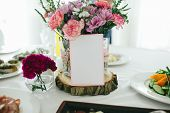 stock photo of wedding table decor  - wedding decor of flowers on the table - JPG