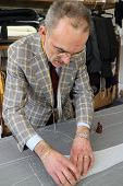 picture of tailoring  - Real tailor in a small town near Assisi in Italy - JPG
