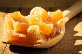 foto of candy  - Closeup candied crystallized ginger candy pieces on wooden spoon - JPG