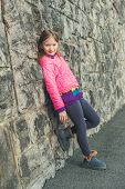 stock photo of leggins  - Outdoor portrait of a cute little girl on the street - JPG