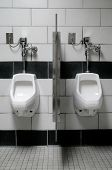 image of urinate  - Two wall mounted urinals in a men - JPG