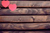 picture of valentines  - Red heart stickers on a dark wooden background - JPG