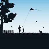 stock photo of kites  - Silhouettes of a happy family of the child and the father with kite on blue background - JPG