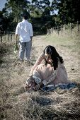 pic of indian beautiful people  - Beautiful young Indian couple relaxing outdoors in long grass - JPG