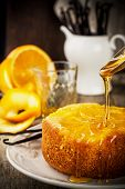 picture of upside  - Orange Upside Down Cake with vanilla and honey on wooden background - JPG