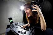 picture of emcee  - caucasian female dj using a mixer and computer to play mp3s - JPG