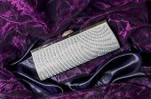picture of clutch  - clutch with pearls on a silk background - JPG