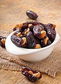 image of lenten  - Oriental sweets - sun dried dates stuffed with cashew ** Note: Shallow depth of field - JPG