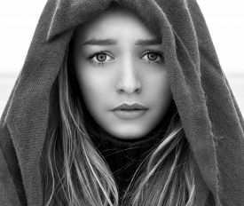 foto of sad  - black and white portrait of a beautiful young girl with big eyes with a sad mood - JPG