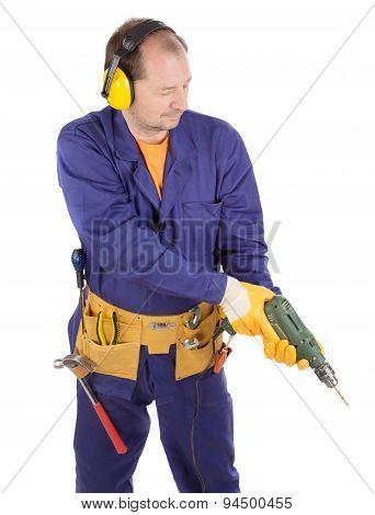 Worker holding drill as gun.