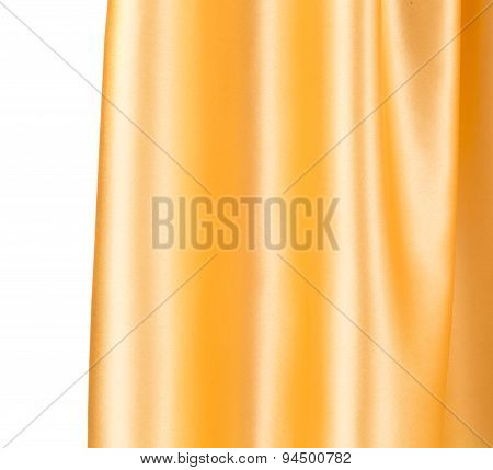 Close up of golden silk cloth texture.