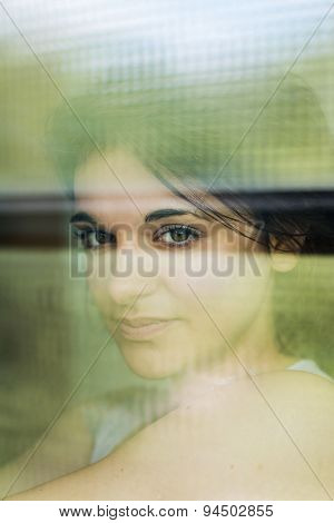 Portrait of woman through glass