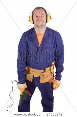 Worker holding drill.