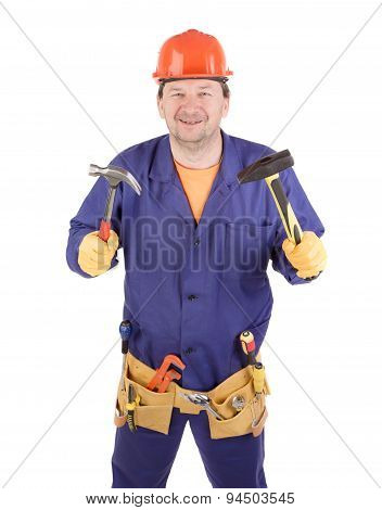 Worker in hard hat holding hammers.