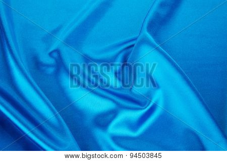 Folds of light blue silk cloth.