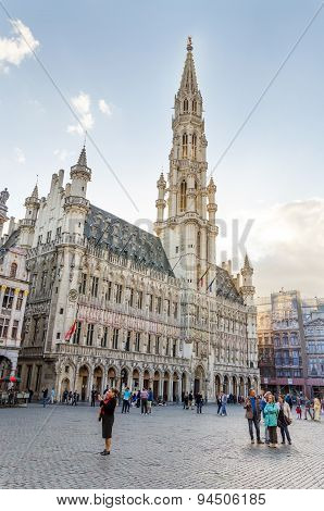Brussels, Belgium - May 13, 2015: Many Tourists Visiting Famous Grand Place Of Brussels.