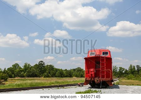 Caboose Beside Tracks