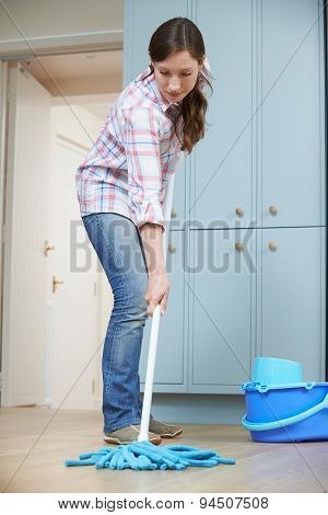 Woman Cleaning Kitchen Floor With Mop