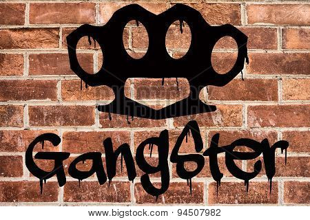 Gangster graffiti on brick wall