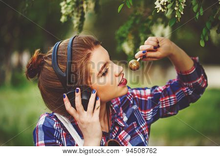 Hipster Girl With Headphones And Lollipop.
