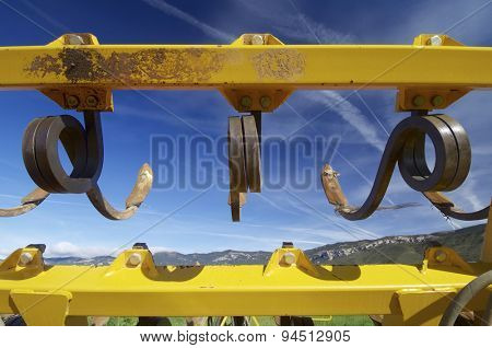 tool for agricultural tillage yellow and blue sky.
