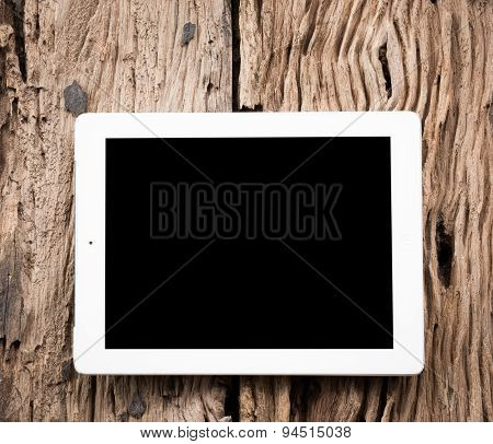White Tablet On Wooden