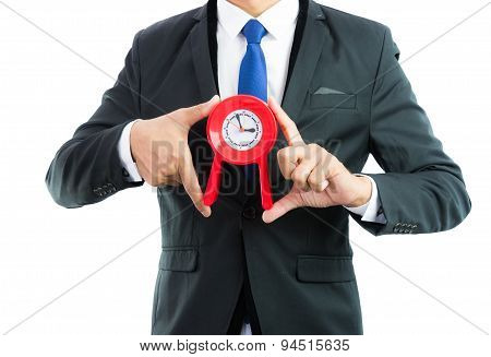 Red Clock Holding In Businessman Hands Isolated