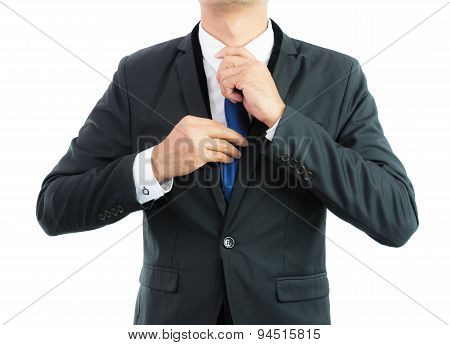 Businessman Adjusting Necktie Isolated