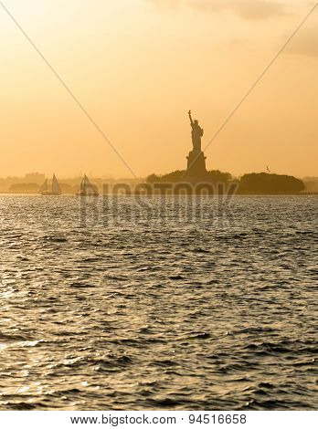 Statue Of Liberty Before Sunset In Hazy New York Harbor